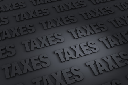 A dark background of gray TAXES receding into the distance Stock Photo