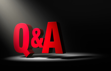 questioning: Large, red Q&A in the dark, illuminated by a single spotlight from above left.