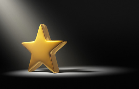 A spotlight brightly illuminates a single gold star on a dark background.