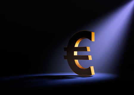 dramatically: A gold Euro sign on a black background is dramatically lit from behind and above by a pale purple spotlight. Stock Photo