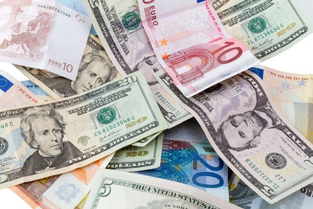 Dollar and Euro notes pile close