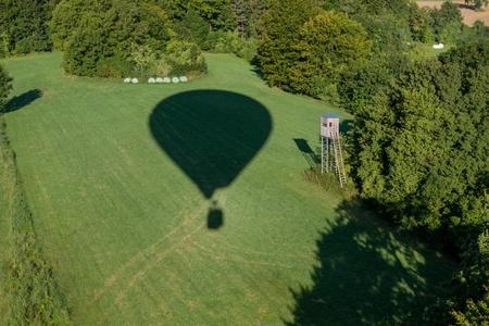 Hot-air ballons shadow near a hunters hide Stock Photo