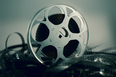 video cameras: Film reel with celluloid around green atmosphere