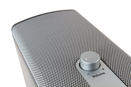 Loudspeaker with a msilver mesh and volume poti Stock Photo - 18223118