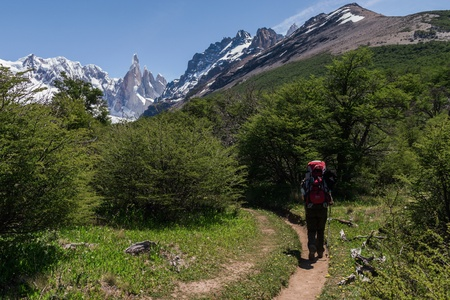 el chalten: Cerro Torre from trekking road heading to the base camp with trekking person