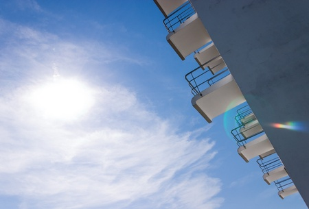 rationalism: Balconies at the Bauhaus in Dessau horizontal with lens flare