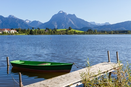Alps panorama with lake, runway and boat Stock Photo