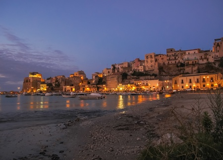 Evening scene in an harbour in Sicily Stock Photo