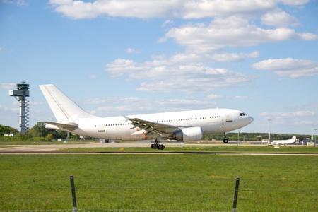 to depart: Airplane landing on runway