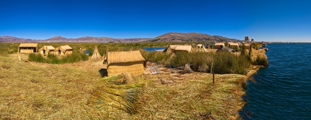 Titicaca lake Peru Uro huts on floating island PANORAMA Stock Photo