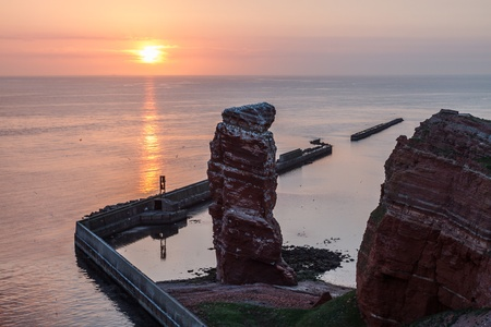 helgoland: Sundown on Helgoland with Lange Anna and calm sea Stock Photo