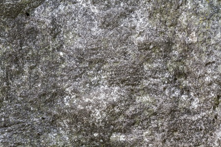 Stone surface with moss texture weather beaten Stock Photo