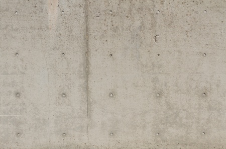 borehole: Large concrete wall with several holes for text