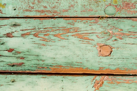 Green painted wooden surface very used
