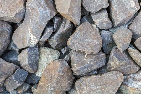 Stone pebbles in grey near a railroad Stock Photo