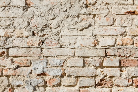 bedraggled: Bedraggled brick wall in dusted yellow detail Stock Photo