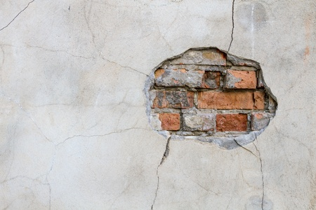 reconstruct: Hole in a wall red bricks looking out Stock Photo