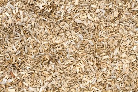 Wooden mulch on the ground in a garden Stock Photo