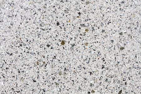 worked: White gleaming granite structure on a worked stone Stock Photo