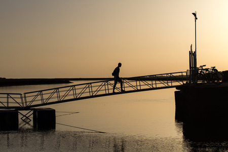 Bridge with man in sunset photo