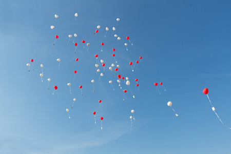 Heart ballons in front of blue sky