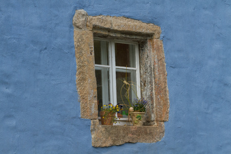 Beautiful ancient window on a blue wall photo