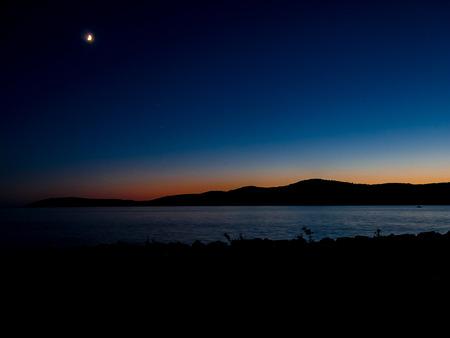 Sunset in mediterranean croatia with shining moon