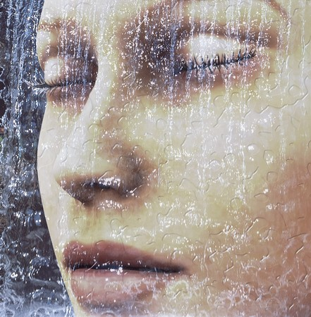 Digital composition of a female face  one of four elements: water photo