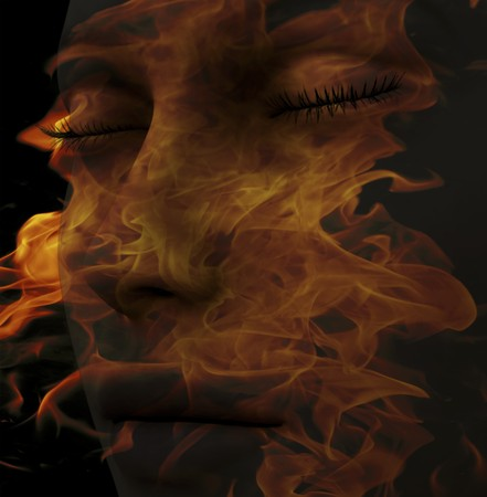 skin burns: Digital composition of a female face  one of four elements: fire Stock Photo