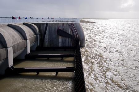 pile dwelling: storm flood at eidersperrwerk near st. peter-ording, germany