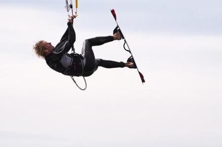 ST. PETER-ORDING, GERMANY - JULY 22: Professional  kite-surfer Karsten Koschewski, Germany,  demonstrating his ability on the Palmolive Kitesurf Worldcup 2010 in St. Peter-Ording, July 22, 2010 in St. Peter-Ording, Germany Stock Photo - 8449773