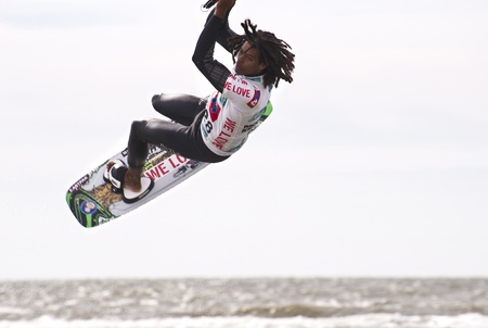 ST. PETER-ORDING, GERMANY - JULY 22: Professional  kite-surfer Emmanuel Norman, Germany,  demonstrating his ability on the Palmolive Kitesurf Worldcup 2010 in St. Peter-Ording, July 22, 2010 in St. Peter-Ording, Germany Stock Photo - 8449794