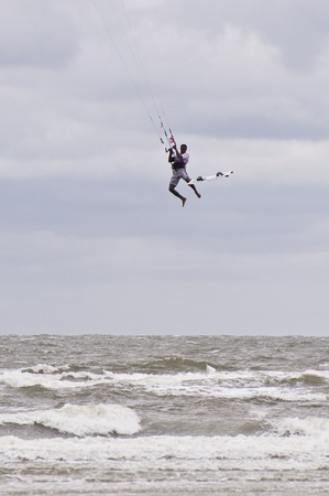ST. PETER-ORDING, GERMANY - JULY 24: Professional kite-surfer demonstrating his ability on the Palmolive Kitesurf Worldcup 2010 in St. Peter-Ording, July 24, 2010 in St. Peter-Ording, Germany Stock Photo - 8449814