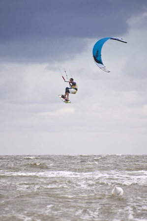 ST. PETER-ORDING, GERMANY - JULY 24: Professional kite-surfer demonstrating his ability on the Palmolive Kitesurf Worldcup 2010 in St. Peter-Ording, July 24, 2010 in St. Peter-Ording, Germany Stock Photo - 8449829