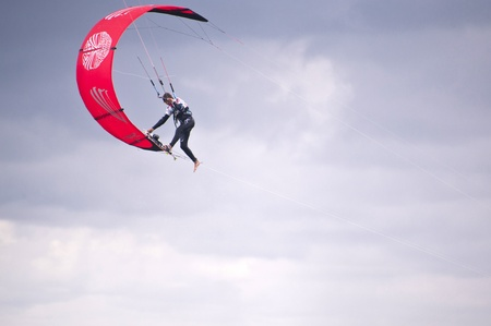 kitesurf: ST. PETER-ORDING, GERMANY - JULY 24: Professional kite-surfer demonstrating his ability on the Palmolive Kitesurf Worldcup 2010 in St. Peter-Ording, July 24, 2010 in St. Peter-Ording, Germany