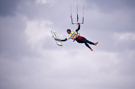 kiter: ST. PETER-ORDING, GERMANY - JULY 24: Professional kite-surfer Gunnar Biniasch, Germany, demonstrating his ability on the Palmolive Kitesurf Worldcup 2010 in St. Peter-Ording, July 24, 2010 in St. Peter-Ording, Germany
