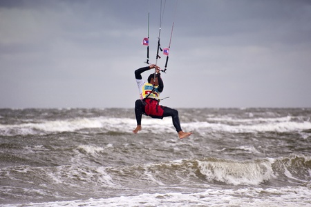 kiting: ST. PETER-ORDING, GERMANY - JULY 24: Professional kite-surfer Gunnar Biniasch, Germany, demonstrating his ability on the Palmolive Kitesurf Worldcup 2010 in St. Peter-Ording, July 24, 2010 in St. Peter-Ording, Germany