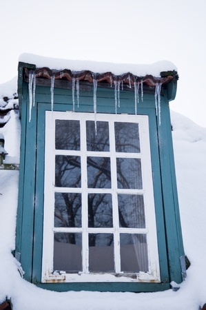 icicled: house in a snowy winter Stock Photo