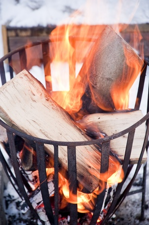 yule tide: warming up on a campfire