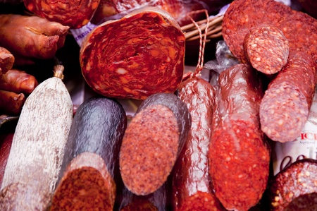 air dried salami: Sausages in a Market Hall Stock Photo