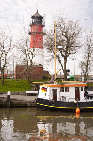 shrimp boat: Lighthouse in Buesum, Germany Editorial