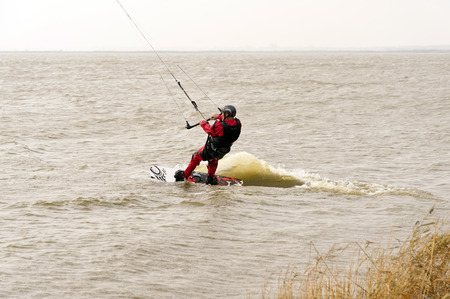 kiter: Surfer on a Bay in Germany Editorial
