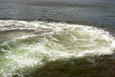 spume: Spume on the Water Surface Stock Photo