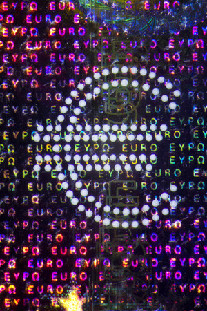 devaluation: Micro Photo of a Hologram on an Euro Bill Stock Photo
