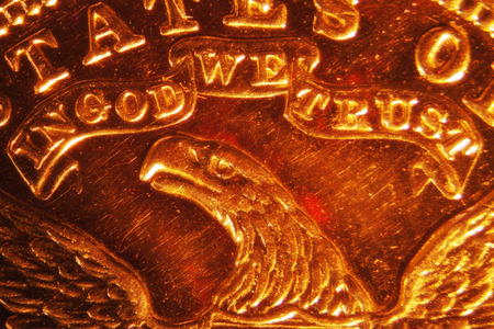 in god we trust: Micro Photo of a Gold Coin Stock Photo