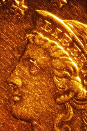 Micro Photo of a Gold Coin Stock Photo