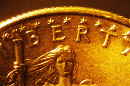 Micro Photo of a Gold Coin Stock Photo