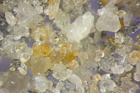 magnified: Micro photography of sand grains Stock Photo