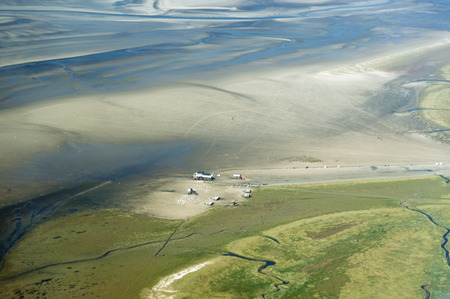 pile dwelling: Aerial view from the Schleswig-Holstein Wadden Sea National Park in Germany Stock Photo