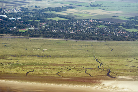 wadden sea: Aerial view from the Schleswig-Holstein Wadden Sea National Park in Germany Stock Photo